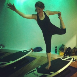 Really, how can you not smile while holding dancer pose on a wobbly surfboard?